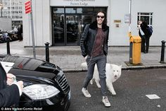 Companion: Russell arrived at the Comic Relief conference with Brian in tow...