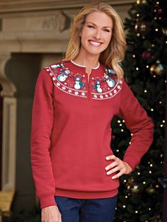 Frosty friends dance along the neckline of this printed fleece top from Blair.