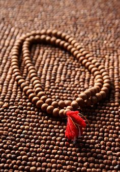 Japa mala is a set of beads commonly used by Hindus and Buddhists, usually made from 108 beads, though other numbers, usually divisible by 9, are also used. Malas are used for keeping count while reciting, chanting, or mentally repeating a mantra or the name or names of a deity.