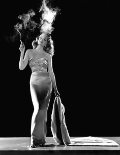 Rita Hayworth, 1946, wearing a gown designed by Jean Louis in a publicity shot for Gilda (Charles Vidor, 1946) via saltypopcornstories