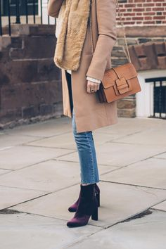 Pair your favorite velvet booties with raw-hem jeans. Top this look off with a neutral coat and scarf. Let DailyDressMe help you find the perfect outfit for whatever the weather!