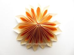 Origami Dahlia...a chain of these beautiful paper flowers would be so pretty against a wall in Ellie's room.