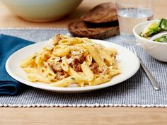 Rachael Ray tosses penne pasta in a sauce of creamy pumpkin and sweet sausage for a filling fall meal that's ready in just 25 minutes.