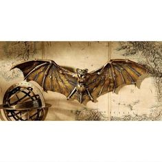 With a wingspan over a foot-and-a-half wide, our stylized Steampunk bat commands attention on your wall like a mechanized fantasy. Cast in quality designer resin and hand-painted in a burnished antiqu