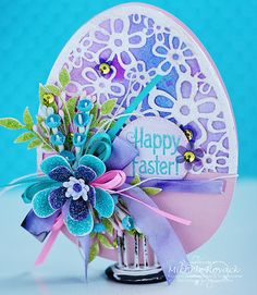 Beautiful Easter egg using a cut from Silhouette. The sentiment is by JustRite and the flowers by Papertrey Ink.