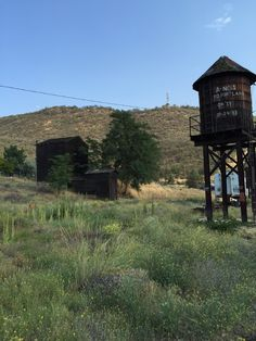 Abandoned water tower for steam engine train