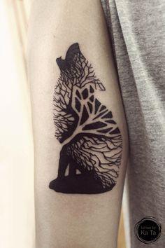 Tree wolf tattoo - geometric arm tattoo on TattooChief.com