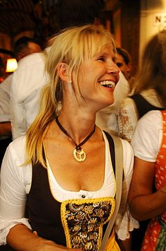Woman wearing a traditional dress, called a Dirndl, in a beer tent at the Oktoberfest Beer Festival or Wies'n in Munich, Bavaria, Germany, Europe