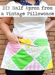A vintage pillowcase and a ribbon belt from the thrift store are perfectly paired together in this simple sewing project idea for a half apron or waist apron. A few folds and a few stitched lines is all it takes! Perfect to use while working a yard sale, flea market, or for hands-free shopping, as well. #upcycled #vintagepillowcase #vintagesewing #halfapron #DIYapron #vintagelinens #vintagefabric #ribbonbelt #waistapron #sewingideas #sewingprojects #vintagesheets