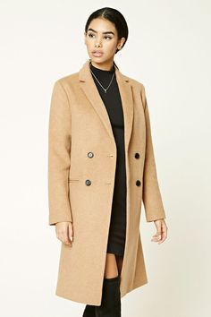 A midweight wool-blend coat featuring a longline silhouette, notched lapels, double-breasted design, long sleeves, front slip pockets, and a satin lining.