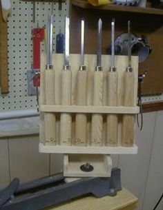 wood lathe tool rack that mounts to the lathe bed... genius idea really...especially since I don't do many spindles...