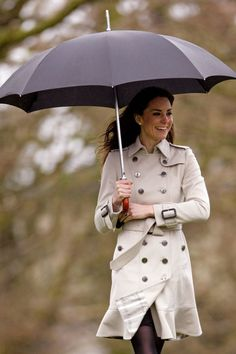 Kate Middleton, March 2011. See the full evolution of the trench coat, from Marlene Dietrich's feminine spin on it in the 1930s to Emma Watson's studded take in the 2010s.