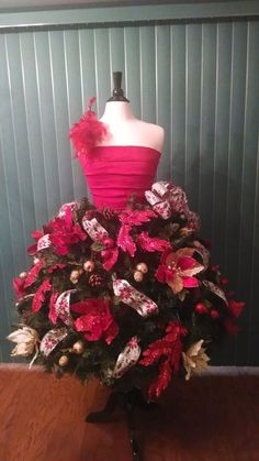 One of our customers bought a dress form from us and modified our Dress Form Christams Tree tutorial to create ths beautiful fashionista Christmas tree