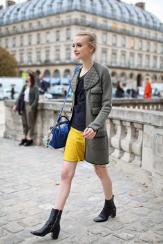 Love the pops of primary color juxtaposed with the chic neutral toned coat and Beatle-esque booties.