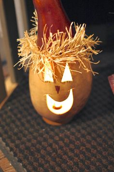 Scarecrow lighted pumpkin