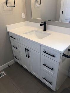 White quartz counter with matte black cabinet hardware White Bathroom Cabinets, Bathroom Renos, Laundry In Bathroom, Small Bathroom, Bathroom Ideas, Light Grey Bathrooms, Washroom, Bathroom Fixtures, Master Bathroom
