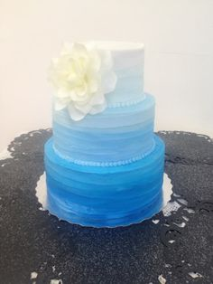 A blue ombre wedding cake that I made for a...