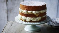 A stunning three-tiered cake filled with homemade lemon curd and cream. To save time, use a good quality ready-made lemon curd. Bake Off Recipes, Dessert Recipes, Lemond Curd, Mousse Au Chocolat Torte, Lemon Drizzle Cake, Lemon Curd Cake, Vanilla Cake, Table D Hote, Cake Mixture