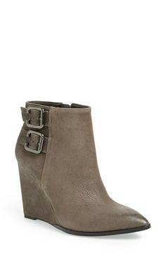 Free shipping and returns on Vince Camuto 'Karmel' Boot (Women) at Nordstrom.com. Polished goldtone buckles highlight the clean, contemporary profile of a pointy-toe ankle boot cast in smooth leather and set on a sleek wedge heel.