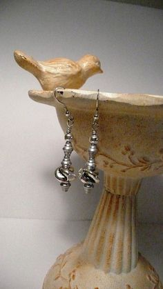 Hey, I found this really awesome Etsy listing at https://www.etsy.com/listing/85719463/ooak-silver-knot-dangle-pierced-earrings