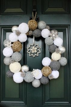 a mix of yarn balls and sparkling ornaments make a great modern winter wreath for the