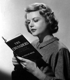 Angela Lansbury reading The Crusaders, 1948. Lansbury (1925-) is a British character actress, long in the United States. She was contracted by MGM while still a teenager and nominated for an Academy Award for her first film, Gaslight (1944). Two pictures later, she was again nominated for Best Supporting Actress, this time for The Picture of Dorian Gray (1945).