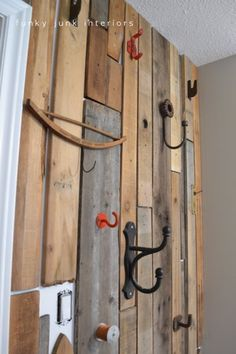 Funky Junk Interiors: Bedroom Redo Part 3- a pallet wood closet wall
