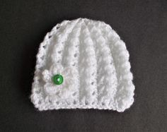 Little Surprise Baby Hat | This sweet knit hat features a delicate flower embellishment. The perfect spring accessory!