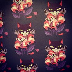 Black cat print seen on the walls and on the coats at the # MiuMiu spring-summer 2014 show