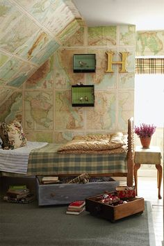 Maps, maps, maps! All over this husky, attic bedroom decorated in lovely, Fall colours.