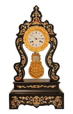 Beautiful large #portico #clock in blackened wood, ebony veneer and #marquetry. Superb blend of golden brass and ivory colored (red, blue, green and pink). White enamel dial-plate chiseled with #ormolu, balance-wheel in bronze. Woodwork covered with a beautiful french varnish. Louis-Phillipe, circa #1850. For sale on Proantic by Clock Prestige.