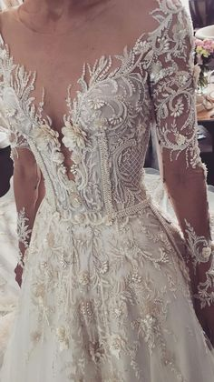 Long sleeves illusion v neckline heavy embellishment a line wedding dress #wedding #weddingdress #weddinggown