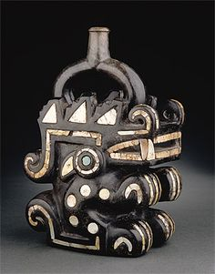 Stirrup vessel in the form of a 'moon animal' 100-800 AD ceramic, mother-of-pearl, turquoise