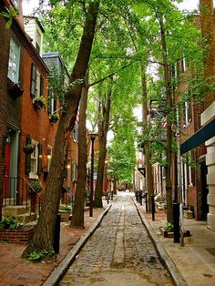 The cobblestone streets add a special little touch. Philadelphia, Pennsylvania. There are original firebrands from insurance companies on the 1700s on some of these homes!
