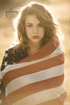beautiful high school senior portrait with flag for 4th of July  America ©2014 Leanna's Reflections Photography