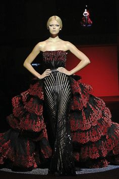 Drama mama: Inspired by the Spanish dress, Michael Cinco¿s interpretations of the sexy flamenco gown were manifested in sheer silk tulles.