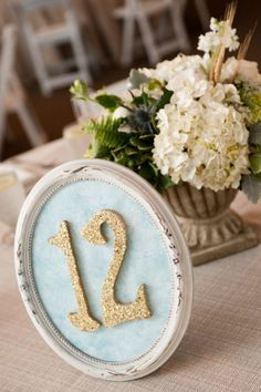 Using picture frames for table numbers..