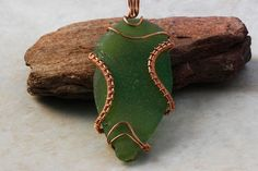 Isuize: 265-Double sided Sea glass copper wire wrapped pendant