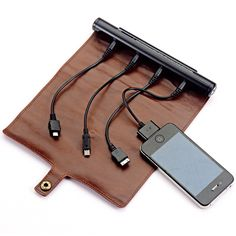 Restoration Hardware Roll Up Travel Charger: No more crawling on a hotel carpet searching for an outlet.