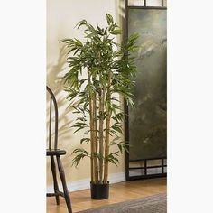 Create a tropical feeling in your home with artificial bamboo trees