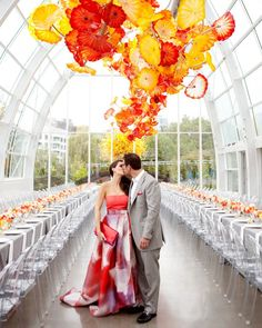 Location and Catering: Chihuly Garden and GlassEvent Coordination, Design, and Flowers: Sinclair & MoorePhotography: Belathée PhotographyVideography: The Ranch StudiosStationery: La HappyRentals: ABC Special Event Rentals by CORT; Choice LinensHair and Makeup: Erin SkipleyTransportation: Butler SeattleFireworks Viewing Venue: The Space Needle