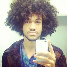 Natural Black Guys Rock: Photo He's not a sister, but he pretty. http://www.shorthaircutsforblackwomen.com/coconut-oil-for-hair/