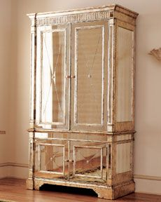 Stacey London says there are four ways to add interest to an outfit: color, pattern, texture, and shine. The same is true for any room you design. And what better way to add some shine to your bedroom than with this beautiful mirrored armoire! Gorgeous!