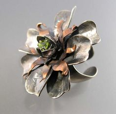 Ring | Nancy LT Hamilton. Sterling, Copper, Peridot.