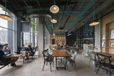 Hubba-to Coworking Offices – Bangkok with bold turquoise M&E lines