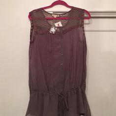 Gray chiffon tunic blouse Tag is 2x runs small.  Fits like an XL Mine Too Tops Tunics