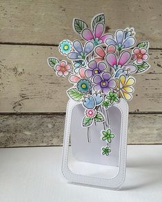 handmade card ... jar shaped with delightful fantasy flowers ...