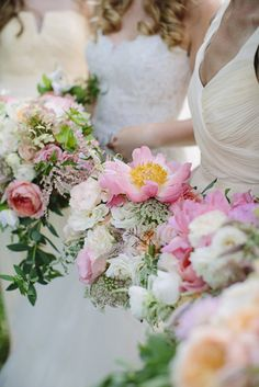 We are head over heels for these bouquets: http://www.stylemepretty.com/pennsylvania-weddings/lancaster/2015/04/17/elegant-and-contemporary-summer-farm-wedding/   Photography: Brooke Courtney - http://www.brookecourtney.com/