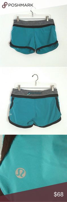 Lululemon Teal & Gray Running Shorts In like new condition. Worn less than a handful of times. Lululemon teal and gray running shorts. lululemon athletica Shorts