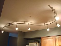 kitchen track lighting on pinterest country kitchen lighting